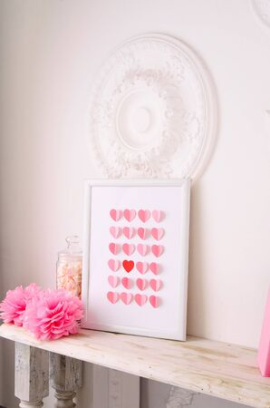 singular: valentines day design with many paper hearts in picture frame in pink and white Stock Photo