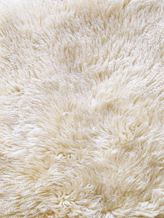 wool rugs: The wool texture of a fluffy sheepsking rug  Stock Photo