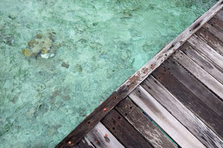 wooden dock: wooden dock triangle over clear water
