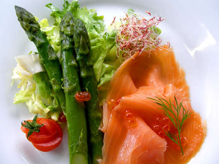 A plate of asparagus and smoked salmon ready to serve Stock Photo
