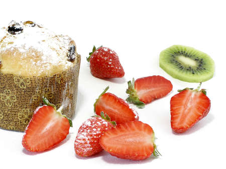 Italian pannetoni served with strawberries and kiwi, sprinkled with icing sugar