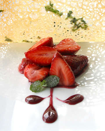 Strawberries with a thin pastry and a red wine sauce
