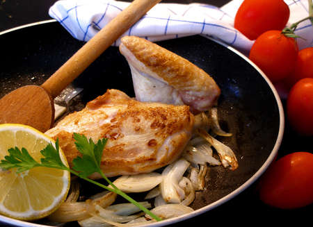 Breast of chicken with lemon and onion Stock Photo