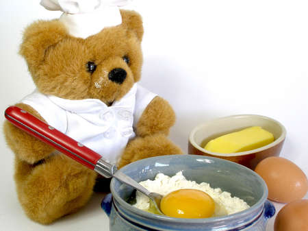 Teddy bear is preparing a cake, i guess. Please,clean your nose, Teddy!