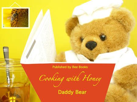 Teddy Bear is looking for recipes using honey Stock Photo