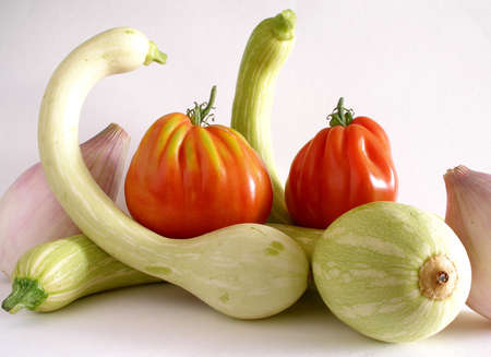 A selection of trumpet zucchini,beef tomato and sweet onion