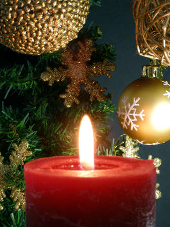 Christmas decoration with a red candle and 3 balls Stock Photo
