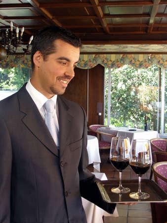 Up class butler is serving wine