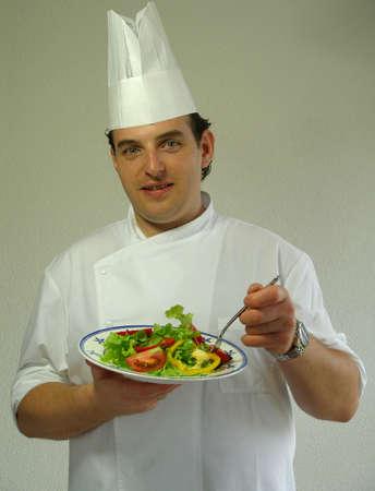 Chef Gabriel is tasting a mixed salad