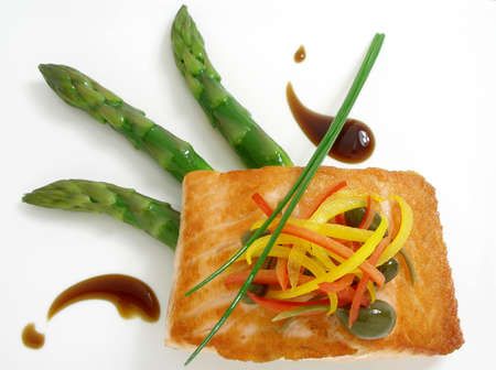 Panfried salmon with asparagus and capers Stock Photo