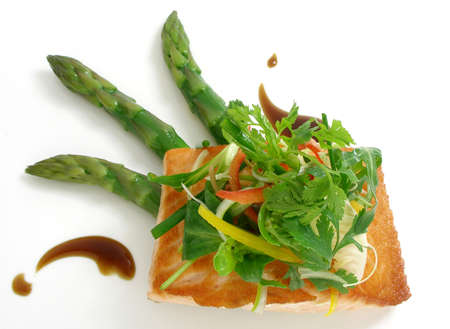 Panfried salmon with asparagus salad and capers