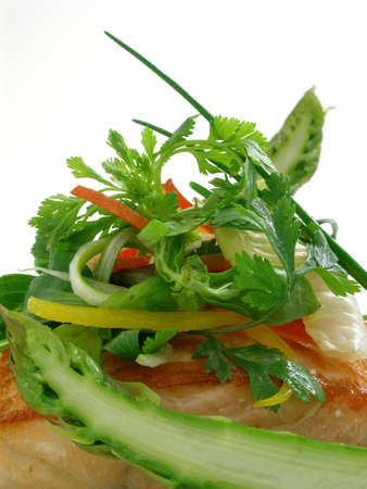 Panfried salmon with asparagus and salad leaves