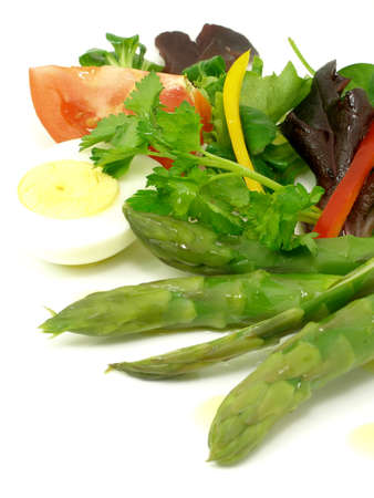 Salad of vegetables and asparagus with boiled egg Stock Photo