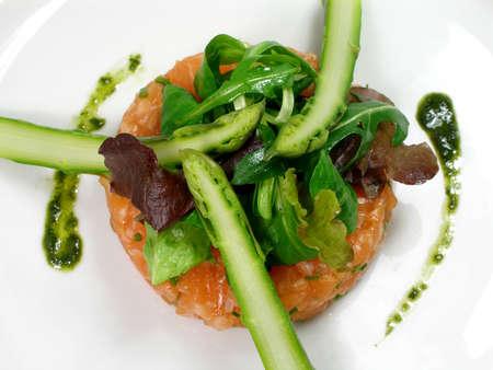 Salmon tartar with asparagus, salad and pesto