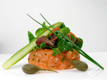 Salmon tartar with salad, green asparagus capers and chives