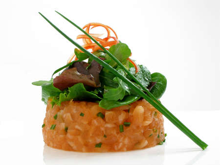 Salmon tartar with salad and chives