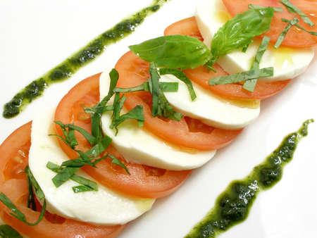 Tomato and mozzarella salad with basil          Stock Photo