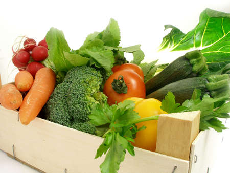 A cornucopia of vegetables coming from the market in a wooden box