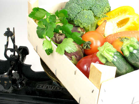 Vegetables coming from the market in a wooden box on a scale