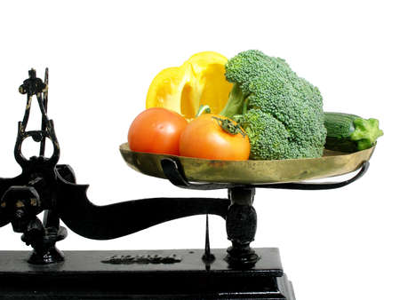 Vegetables on a tray scale as a suggestion that vegetables are good for diet Stock Photo