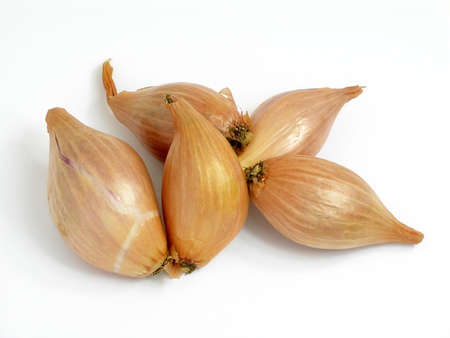 Five shallots arranged on a table