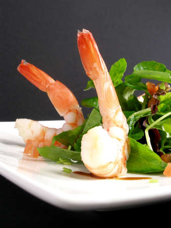 Prawns salad apetizer focus on foreground         Stock Photo