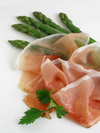 Green asparagus and prosciutto served on a platter