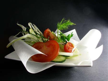 preparing a parcel of vegetables to bake