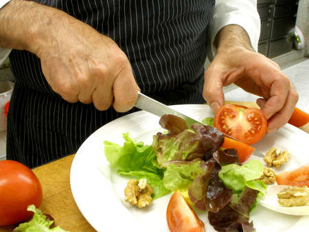 preparing a plate of salad with walnuts