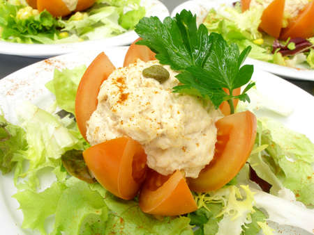stuffed fish: Plates of stuffed tomato with tuna fish