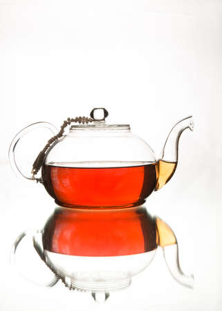 rosy: Rosy black tea in glass teapot. Afternoon tea. Isolated in white background.