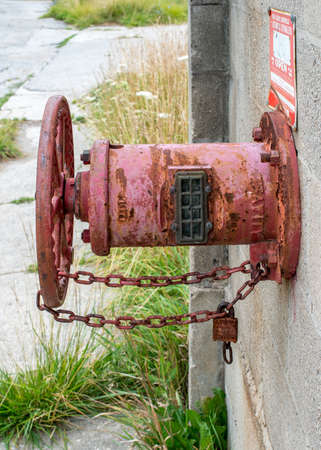 abandoned factory: Rustic manual valve outside of an abandoned factory. Stock Photo