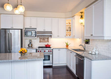 cabinets: Professionally designed new kitchen with touch of retro. Professional gas range and hood, white cabinet,  antique ceiling lamp, fine bone china teacups in cabinets. Interior design ideas.