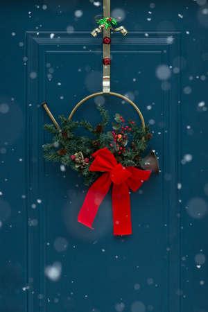 heavy snow: Christmas wreath in heavy snow on blue outside door. Stock Photo