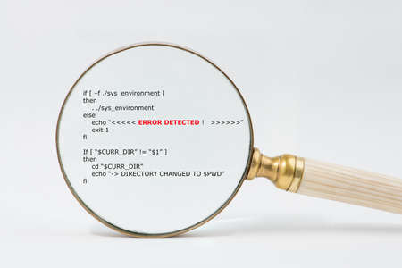 debugging: Antique brass magnifier with bone  ivory handle magnifies short unix scripts. Text in focused  shows the Error Detected. Audit, compliance, data reconciliation, software debugging concept. Stock Photo