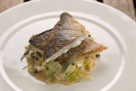 sea bream: Pan fried sea bream with leeks, crab capers & tarragon Stock Photo