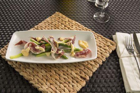 iberico: English asparagus, Iberico ham & Truffled hollandaise Stock Photo