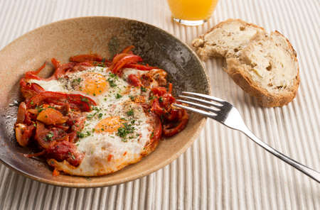 spiced: Turkish spiced Menemen eggs with onions peppers, chilli & tomato Stock Photo