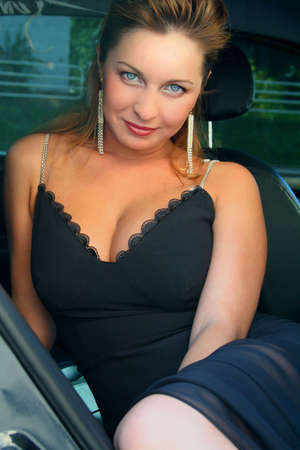 ladies bust: pretty woman sits in salon of the car,
