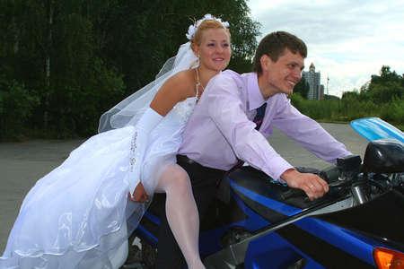 bride & bridegroom on the motorcycle photo