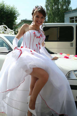 lucky bride demonstrates their own legs photo