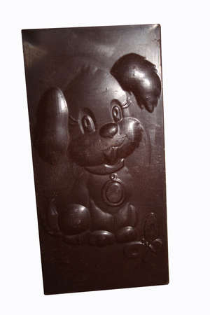 drollery: puppy is expressed on bar of chocolate with butterfly