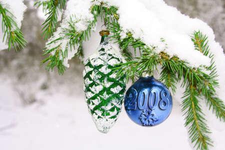 snow  & toys on the fir-tree Фото со стока