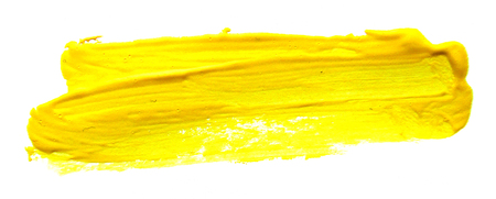 Yellow abstract gouache brush stroke on a white background Banque d'images