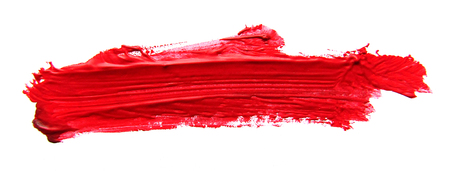 Red abstract gouache brush stroke on a white background