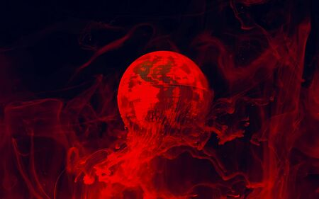 Planet earth on fire from space. Red watercolor ink in water on a black background. Ecology and the environment. Save the planet. Ecological catastrophy. Depletion of the Earth.