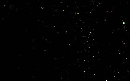 Confettis dorés. Abstrait avec des étincelles scintillantes dorées et brillantes. Des particules de poussière d'or scintillent. Particules de lumière volantes et vacillantes.