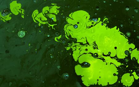 Green watercolor ink in oil water. Cool trending screensaver. Abstract trending background. Фото со стока