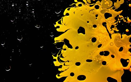 Yellow watercolor ink in black oil water. Cool trending screensaver. Abstract trending background. Фото со стока