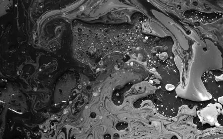 Black and white watercolor ink in oil water. Cool trending screensaver. Abstract trending background.